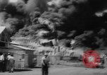 Image of Oil company warehouse under fire San Juan Puerto Rico, 1967, second 33 stock footage video 65675043046