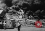 Image of Oil company warehouse under fire San Juan Puerto Rico, 1967, second 34 stock footage video 65675043046