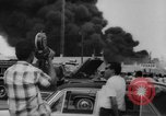 Image of Oil company warehouse under fire San Juan Puerto Rico, 1967, second 43 stock footage video 65675043046