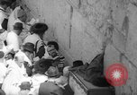 Image of Jewish New Year at Western Wall Jerusalem Israel, 1967, second 26 stock footage video 65675043048