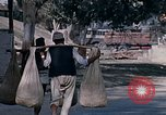 Image of group of local men Kathmandu Nepal, 1969, second 14 stock footage video 65675043061