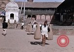 Image of group of local men Kathmandu Nepal, 1969, second 37 stock footage video 65675043061