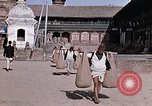 Image of group of local men Kathmandu Nepal, 1969, second 39 stock footage video 65675043061