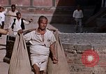 Image of group of local men Kathmandu Nepal, 1969, second 53 stock footage video 65675043061