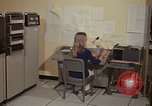 Image of Woman operates computer controls New Mexico United States USA, 1975, second 21 stock footage video 65675043085