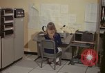 Image of Woman operates computer controls New Mexico United States USA, 1975, second 22 stock footage video 65675043085