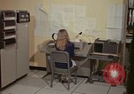 Image of Woman operates computer controls New Mexico United States USA, 1975, second 23 stock footage video 65675043085