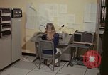 Image of Woman operates computer controls New Mexico United States USA, 1975, second 25 stock footage video 65675043085