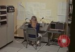 Image of Woman operates computer controls New Mexico United States USA, 1975, second 26 stock footage video 65675043085