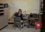 Image of Woman operates computer controls New Mexico United States USA, 1975, second 27 stock footage video 65675043085