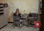 Image of Woman operates computer controls New Mexico United States USA, 1975, second 28 stock footage video 65675043085