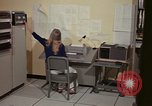 Image of Woman operates computer controls New Mexico United States USA, 1975, second 29 stock footage video 65675043085