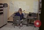 Image of Woman operates computer controls New Mexico United States USA, 1975, second 30 stock footage video 65675043085