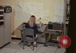 Image of Woman operates computer controls New Mexico United States USA, 1975, second 33 stock footage video 65675043085
