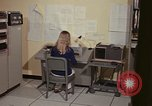 Image of Woman operates computer controls New Mexico United States USA, 1975, second 34 stock footage video 65675043085