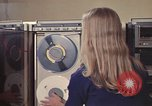 Image of Woman operates computer controls New Mexico United States USA, 1975, second 38 stock footage video 65675043085