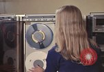 Image of Woman operates computer controls New Mexico United States USA, 1975, second 39 stock footage video 65675043085