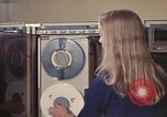 Image of Woman operates computer controls New Mexico United States USA, 1975, second 40 stock footage video 65675043085