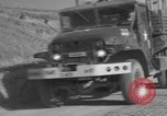 Image of United States military trucks Korea, 1954, second 32 stock footage video 65675043228