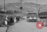Image of United States military trucks Korea, 1954, second 57 stock footage video 65675043228
