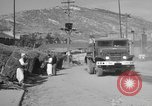 Image of United States military trucks Korea, 1954, second 58 stock footage video 65675043228