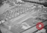Image of B-24 bombers attack oil refineries and storage facilities Labuan Island Borneo , 1944, second 45 stock footage video 65675043293