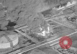 Image of B-24 bombers attack oil refineries and storage facilities Labuan Island Borneo , 1944, second 60 stock footage video 65675043293