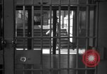 Image of Prisoners in prison with fine landscaping United States USA, 1940, second 4 stock footage video 65675043403