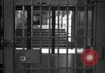 Image of Prisoners in prison with fine landscaping United States USA, 1940, second 10 stock footage video 65675043403