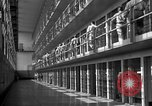 Image of Prisoners in prison with fine landscaping United States USA, 1940, second 27 stock footage video 65675043403