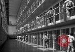 Image of Prisoners in prison with fine landscaping United States USA, 1940, second 29 stock footage video 65675043403
