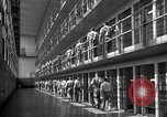 Image of Prisoners in prison with fine landscaping United States USA, 1940, second 35 stock footage video 65675043403