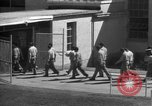 Image of Prisoners in prison with fine landscaping United States USA, 1940, second 55 stock footage video 65675043403