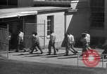 Image of Prisoners in prison with fine landscaping United States USA, 1940, second 56 stock footage video 65675043403