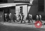Image of Prisoners in prison with fine landscaping United States USA, 1940, second 62 stock footage video 65675043403