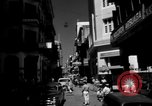 Image of Narrow crowded commercial street Puerto Rico, 1950, second 2 stock footage video 65675043413