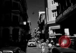 Image of Narrow crowded commercial street Puerto Rico, 1950, second 4 stock footage video 65675043413