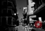 Image of Narrow crowded commercial street Puerto Rico, 1950, second 8 stock footage video 65675043413