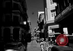 Image of Narrow crowded commercial street Puerto Rico, 1950, second 9 stock footage video 65675043413