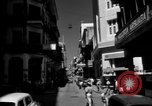 Image of Narrow crowded commercial street Puerto Rico, 1950, second 10 stock footage video 65675043413