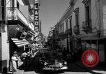 Image of Narrow crowded commercial street Puerto Rico, 1950, second 12 stock footage video 65675043413