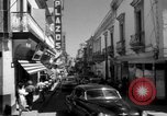 Image of Narrow crowded commercial street Puerto Rico, 1950, second 13 stock footage video 65675043413