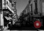 Image of Narrow crowded commercial street Puerto Rico, 1950, second 14 stock footage video 65675043413