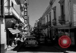 Image of Narrow crowded commercial street Puerto Rico, 1950, second 15 stock footage video 65675043413