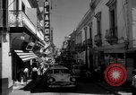 Image of Narrow crowded commercial street Puerto Rico, 1950, second 16 stock footage video 65675043413