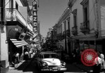 Image of Narrow crowded commercial street Puerto Rico, 1950, second 17 stock footage video 65675043413