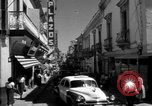 Image of Narrow crowded commercial street Puerto Rico, 1950, second 18 stock footage video 65675043413