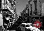 Image of Narrow crowded commercial street Puerto Rico, 1950, second 19 stock footage video 65675043413