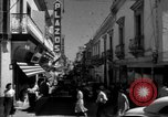 Image of Narrow crowded commercial street Puerto Rico, 1950, second 21 stock footage video 65675043413