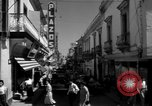 Image of Narrow crowded commercial street Puerto Rico, 1950, second 22 stock footage video 65675043413